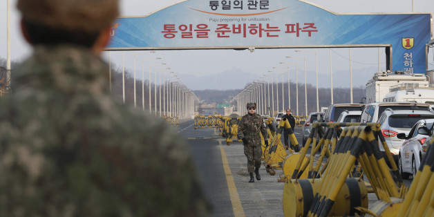 A South Korean army soldier walks on Unification Bridge, which leads to the demilitarized zone, near the border village of Panmunjom in Paju, South Korea, Thursday, Feb. 11, 2016. South Korea said Wednesday that it will shut down a joint industrial park with North Korea in response to its recent rocket launch, accusing the North of using hard currency from the park to develop its nuclear and missile programs. (AP Photo/Ahn Young-joon)