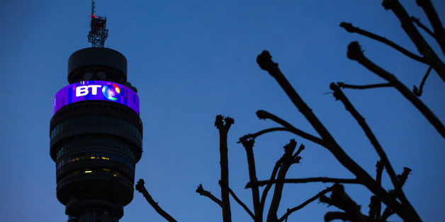 An illuminated BT logo sits above communications equipment on the BT Tower, operated by BT Group Plc, at dusk in London, U.K., on Monday, Dec. 15, 2014. BT started exclusive talks to acquire Deutsche Telekom AG and Orange SA's British wireless venture EE for 12.5 billion pounds ($19.6 billion), moving ahead with a deal that's set to spur more mergers in the U.K. telecommunications market. Photographer: Jason Alden/Bloomberg via Getty Images