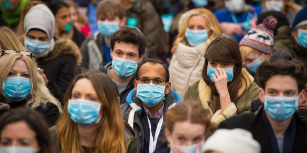 "Junior doctors and their supporters stage sit-down protest outside Downing Street, in Westminster, London, during a ""masked march"" protest over pay and conditions, the third time they have taken to the streets in protest at the Government's proposals, which it says aims to improve care over weekends."