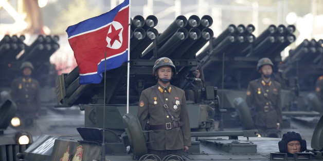 North Korean soldiers stand on armored vehicles with rocket launchers as they parade in Pyongyang, North Korea, Saturday, Oct. 10, 2015. North Korean leader Kim Jong Un declared Saturday that his country was ready to stand up to any threat posed by the United States as he spoke at a lavish military parade to mark the 70th anniversary of the North's ruling party and trumpet his third-generation leadership. (AP Photo/Wong Maye-E)