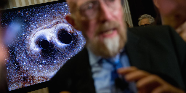 A visual of gravitational waves from two converging black holes is depicted on a monitor behind Laser Interferometer Gravitational-Wave Observatory (LIGO) Co-Founder Kip Thorne as he speaks to members of the media following a news conference at the National Press Club in Washington, Thursday, Feb. 11, 2016, as it is announced that scientists they have finally detected gravitational waves, the ripples in the fabric of space-time that Einstein predicted a century ago. The announcement has electrif