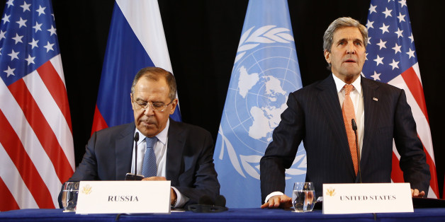 U.S. Secretary of State John Kerry, right, and Russian Foreign Minister Sergey Lavrov arrive for a news conference after the International Syria Support Group (ISSG) meeting in Munich, Germany, Friday, Feb. 12, 2016. (AP Photo/Matthias Schrader)