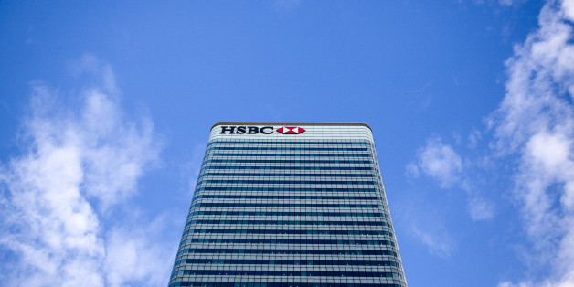 The HSBC Holdings Plc headquarters sits in the Canary Wharf business, financial and shopping district of London, U.K., on Wednesday, Oct. 28, 2015. Europe's largest bank started considering whether to uproot its headquarters from London this year with the board mulling a rising tax burden, tougher regulation and the risk of Britain exiting the European Union in a referendum. Photographer: Simon Dawson/Bloomberg via Getty Images