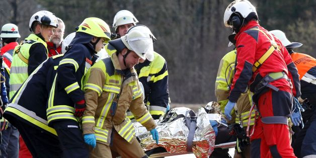 Rescue workers carry a victim from the site of a train accident near Bad Aibling, southern Germany, on February 9, 2016.Two Meridian commuter trains operated by Transdev collided head-on near Bad Aibling, around 60 kilometres (40 miles) southeast of Munich, killing at least eight people and injuring around 100, police said. The cause of the accident was not immediately clear. / AFP / dpa / Uwe LEIN / Germany OUT        (Photo credit should read UWE LEIN/AFP/Getty Images)