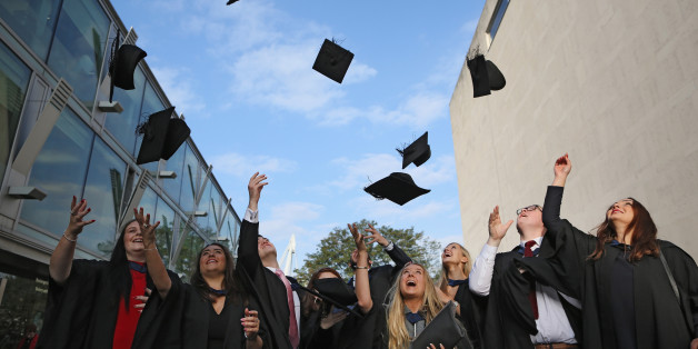 Students celebrate their graduation. Under news plans from Plaid Cymru Welsh graduates would be eligible to have £6,000 wiped off their student debts every year.