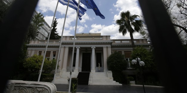 The flags of Greece and European Union flutter outside Maximos Mansion, Prime Minister's office, in Athens on Tuesday, June 23, 2015. The country this week offered a series of measures, including multiple tax increases, to persuade its creditors to release bailout funds and keep the country from defaulting on its debts as soon as next week. (AP Photo/Thanassis Stavrakis)