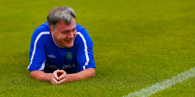 Ed Balls on the pitch after stumbling during the MPs vs lobby journalists football match