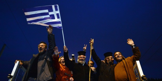 Farmers and priests stand on their tractors and vehicles as they arrive in front of the Greek parliament in Athens during a rally against pension reform, on February  12, 2016.Fears that Greece will exit the eurozone, a 'Grexit', could revive if Greek authorities do not come up with 'credible' reforms, notably on pensions, a senior IMF official said February 11. / AFP / LOUISA GOULIAMAKI        (Photo credit should read LOUISA GOULIAMAKI/AFP/Getty Images)
