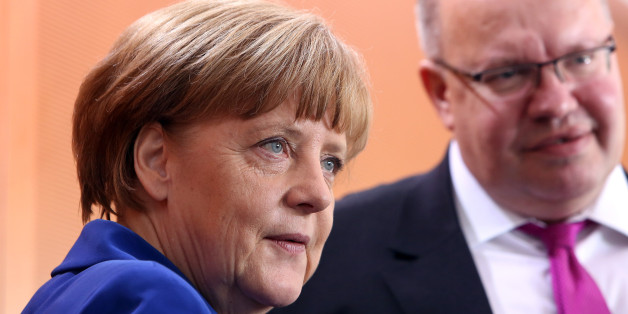BERLIN, GERMANY - MAY 06:  German Chancellor Angela Merkel (CDU) (L) and Minister of the Chancellery Peter Altmeier (CDU) arrive for the weekly German federal Cabinet meeting on May 6, 2015 in Berlin, Germany. Surveillance performed on behalf of the American National Security Agency (NSA) has upset many citizens in a country where, after the Nazi and East German Stasi eras, spying by government bodies remains a sensitive topic. Interior Minister Thomas de Maiziere, who was German Chancellor Ange