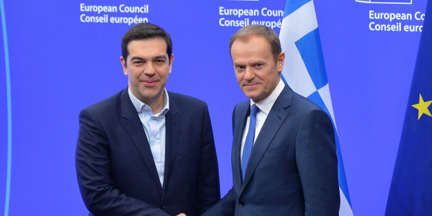 BRUSSELS, BELGIUM - FEBRUARY 4: Greek Prime Minister Alexis Tsipras (L) shakes hands with European Union President Donald Tusk (R) prior to their meeting at the European Union headquarters in Brussels on February 4, 2015. (Photo by Dursun Aydemir/Anadolu Agency/Getty Images)