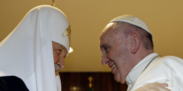 The head of the Russian Orthodox Church Patriarch Kirill, left,  and Pope Francis meet at the Jose Marti airport in Havana, Cuba, Friday, Feb. 12, 2016. This is the first-ever papal meeting with the head of the Russian Orthodox Church, a historic development in the 1,000-year schism within Christianity. (Max Rossi/Pool photo via AP)