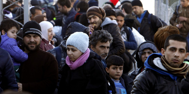 Refugees gather upon their arrival at the transit center for refugees near northern Macedonian village of Tabanovce, before continuing their journey to Serbia, Friday, Feb. 12, 2016. In a dramatic response to Europe's gravest refugee crisis since World War II, NATO ordered three warships to sail immediately Thursday to the Aegean Sea to help end the deadly smuggling of asylum-seekers across the waters from Turkey to Greece. (AP Photo/Boris Grdanoski)