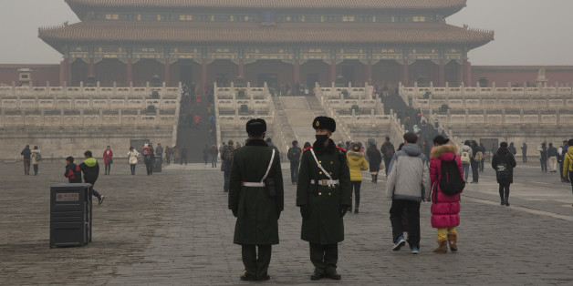 Chinese paramilitary policemen stand guard in the Forbidden City during a smoggy day in Beijing, China, Tuesday, Dec. 22, 2015. Beijing announced its second ever red alert for smog from Dec. 19 to 22, 2015. (AP Photo/Ng Han Guan)