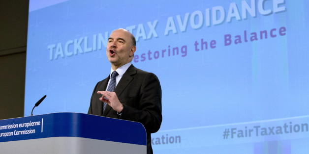 European Commissioner for Economic and Financial Affairs Pierre Moscovici speaks during a media conference at EU headquarters in Brussels on Thursday, Jan. 28, 2016. The European Union has unveiled new measures to combat tax evasion by big companies as part of efforts to end sweet deals between member countries and multinationals. (AP Photo/Virginia Mayo)