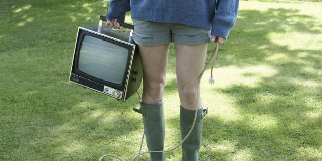 Portrait of  girl holding retro TV