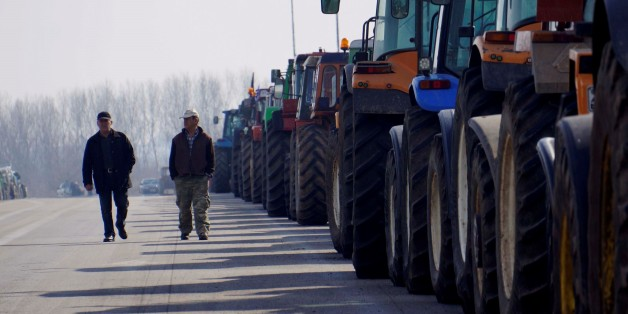 KASTANIES, GREECE - FEBRUARY 01: A group of farmers block the road to Ormenio border gate with their tractors during a protest against government's amendment plans on social security act and additional taxes, on January 01, 2016 in Kastanies, Greece. (Photo by Salih Baran/Anadolu Agency/Getty Images)