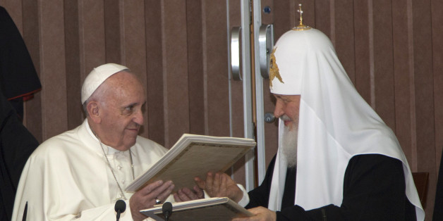 """Pope Francis, left, and Russian Orthodox Patriarch Kirill exchange documents during their historic meeting in Havana, Cuba, Friday, Feb. 12, 2016. Francis and Kirill signed a joint declaration on religious unity. The declaration calls for peace in Syria, Iraq and Ukraine and urges Europe to """"maintain its faithfulness to its Christian roots.""""  (Ismael Francisco/Cubadebate via AP)"""