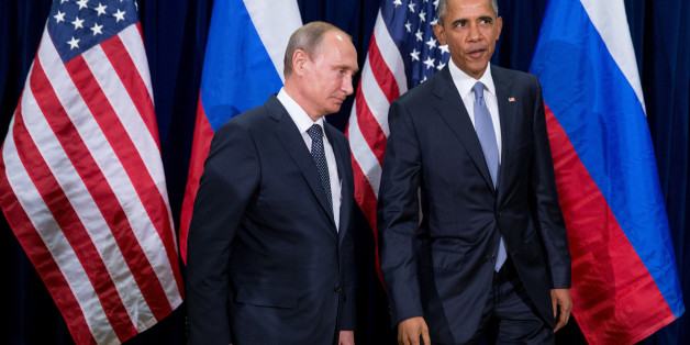 United States President Barack Obama, right, and Russia's President President Vladimir Putin head into a bilateral meeting Monday, Sept. 28, 2015, at United Nations headquarters. (AP Photo/Andrew Harnik)