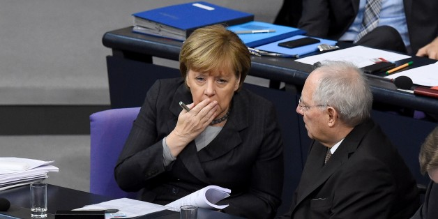 German Chancellor Angela Merkel (L) chats with German Finance Minister Wolfgang Schaeuble during a plenary session of the German lower house of parliament Bundestag before deputies vote on a stepped-up German role in the fight against the Islamic State group in Berlin December 4, 2015. The  mandate would cover six Tornado reconnaissance jets, one refuelling aircraft, a naval frigate and up to 1,200 troops following a request from France after the November 13 jihadist attacks. AFP PHOTO / TOBIAS SCHWARZ / AFP / TOBIAS SCHWARZ        (Photo credit should read TOBIAS SCHWARZ/AFP/Getty Images)