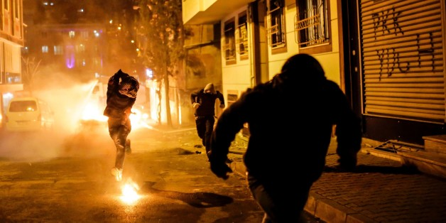 A protestor prepares to throw molotov cocktail at Turkish police during a demonstration against government imposed curfews imposed on areas of eastern Turkey, on February 14, 2016 in Istanbul. / AFP / YASIN AKGUL        (Photo credit should read YASIN AKGUL/AFP/Getty Images)
