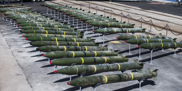 Some of the forty rockets (type M-302), up to the range of 160 kilometres, 181 122mm mortar shells, and approximately 400,000 7.62-calibre rounds are put on display by the Israeli military along the docks of the southern Israeli military port of Eilat, on March 10, 2014. The ammunition was found on a vessel, the Panamanian-flagged Klos-C, which was allegedly transporting arms from Iran to Gaza, and was escorted into the port of Eilat after Israeli naval commandos seized it on March 5, 2014. AFP PHOTO / JACK GUEZ        (Photo credit should read JACK GUEZ/AFP/Getty Images)