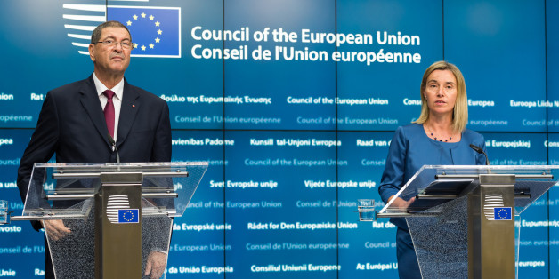 European Union High Representative Federica Mogherini, right, and Tunisia's Prime Minister Habib Essid address the media after a meeting at the EU Council building in Brussels on Monday, July 20, 2015. (AP Photo/Geert Vanden Wijngaert)