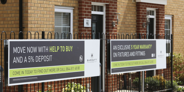 A sign advertising the Government's Help to Buy scheme stands outside new homes