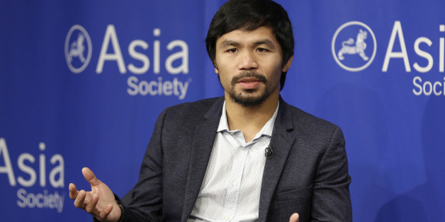 """FILE - In this Oct. 12, 2015, file photo, Manny Pacquiao takes questions at the Asia Society in New York. Boxing star Pacquiao has created a firestorm in his home country after saying people in same-sex relationships """"are worse than animals."""" Pacquiao, who is running for a Philippine Senate seat, made the remark in a video posted Monday, Feb. 15, 2016, on local TV5's election site. He also said animals are better than people in same-sex relationships because they recognize the dif"""