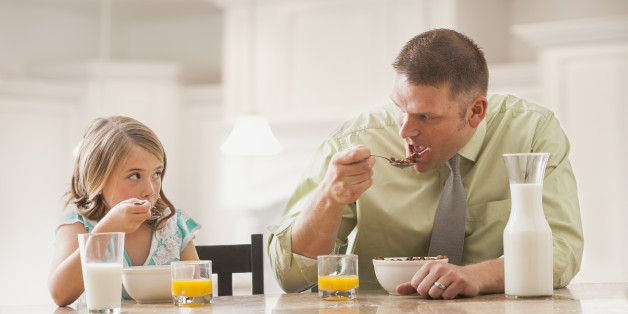 USA, Utah, Lehi, Father and daughter (6-7) eating breakfast