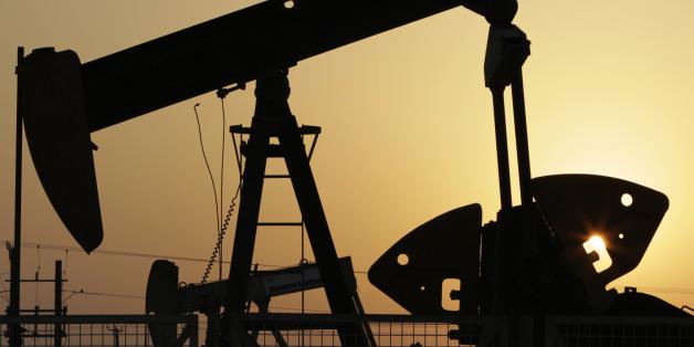 oil pumps work in the desert oil fields of Sakhir, Bahrain.