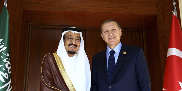 FILE - In this Saturday, Nov. 14, 2015 file photo, Turkish President Recep Tayyip Erdogan right, shakes hands with Saudi King Salman bin Abdul Aziz Al Saud, left, prior to their meeting in Antalya, Turkey ahead of the upcoming G-20 summit. Erdogan is headed to Saudi Arabia where he will meet King Salman for talks focused on the civil war in Syria. Turkey and Saudi Arabia are strong backers of the Syrian Sunni opposition fighting to oust the Iranian-backed Syrian President Bashar Assad from power. (Yasin Bulbul /Turkish Presidency Press Office /Anadolu Agency via AP, Pool, File)