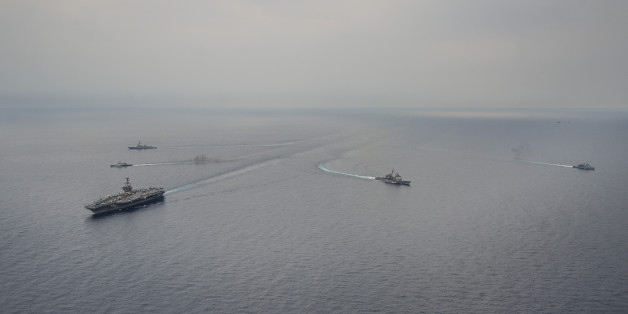 SOUTH CHINA SEA (June 24, 2014) Ships from the George Washington Carrier Strike Group (GWCSG) and Royal Malaysian Navy steam in formation during a photo exercise. The GWCSG is on patrol in the 7th Fleet area of operations supporting security and stability in the Indo-Asia-Pacific region. (U.S. Navy photo by Mass Communication Specialist 1st Class Trevor Welsh/Released)