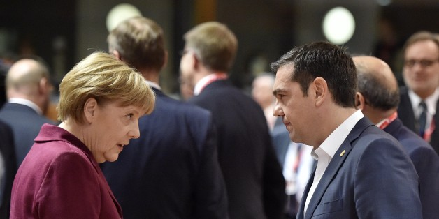 German Chancellor Angela Merkel, left, talks with Greek Prime Minister Alexis Tsipras, right, during the EU summit in Brussels, Belgium on Thursday, Oct. 15, 2015. European Union heads of state meet to discuss, among other issues, the current migration crisis. (AP Photo/Martin Meissner)