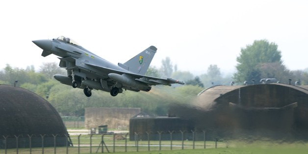 In this photo released by Britain's RAF, one of Britain's Royal Air Force Typhoon aircraft lifts off from an RAF base near Lincoln, England, Monday April 28, 2014, deployed to take part in the NATO Baltic Air Policing (BAP) mission over Estonia, Latvia and Lithuania.  The UK fast jets will reinforce the Polish contribution to provide NATO air policing over Baltic member states. Tensions in eastern Baltic states have escalated in response to the continued unstable situation in Ukraine. (AP Photo / RAF, Cpl Phil Major (RAF))