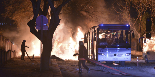Firefighters work at a scene of fire from an explosion in Ankara, Wednesday, Feb. 17, 2016. A large explosion, believed to have been caused by a bomb, injured several people in the Turkish capital on Wednesday, according to media reports. (IHA via AP) TURKEY OUT