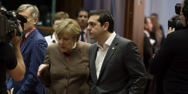 German Chancellor Angela Merkel (L) speaks with Greek Prime Minister Alexis Tsipras (R) before the final European Union (EU) summit of the year at the European Council in Brussels on December 18, 2015.   / AFP / JOHN THYS        (Photo credit should read JOHN THYS/AFP/Getty Images)