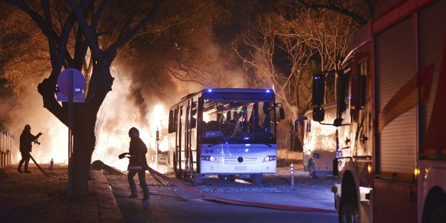 Firefighters work at a scene of fire from an explosion in Ankara, Wednesday, Feb. 17, 2016. A large explosion, believed to have been caused by a bomb, injured several people in the Turkish capital on Wednesday, according to media reports. Private NTV said the explosion occurred during rush hour in an area close to where military headquarters are located as a bus carrying military personnel was passing by. Several cars caught fire, the report said. Ambulances were seen rushing toward the scene. T
