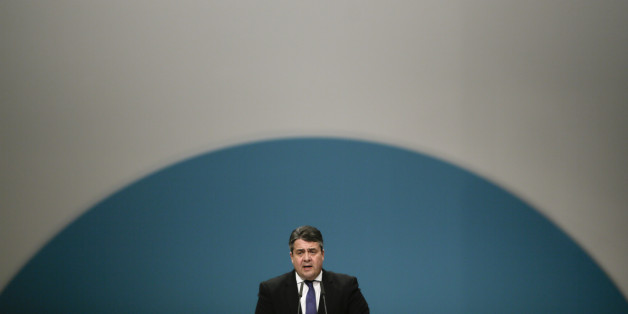 German Social Democratic Party, SPD,  chairman Sigmar Gabriel delivers his speech during the party convention in Berlin, Friday, Dec. 11, 2015. (AP Photo/Markus Schreiber)