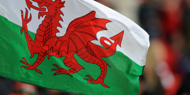 A Wales flag flies in the stands.