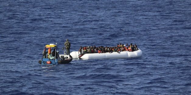 In this photo provided by the Swedish Coast Guard, a tug boat from the ship Poseidon reaches a rubber boat with 130 migrants off  the Libyan coast Wednesday, Aug. 26, 2015. The Swedish ship Poseidon immediately after rescued 439 survivors aboard a wooden ship, discovering in the hull the corpses of 51 migrants who died,  probably of asphyxiation, making the dangerous Mediterranean crossing in hopes of reaching Europe. (Swedish Coast Guard via AP Photo) MANDATORY CREDIT