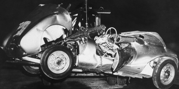 1955:  The mangled remains of 'Little Bastard,' James Dean's Porsche Spyder sports car in which he died during a high-speed car crash, being towed by a tow truck, California.  (Photo by Hulton Archive/Getty Images)