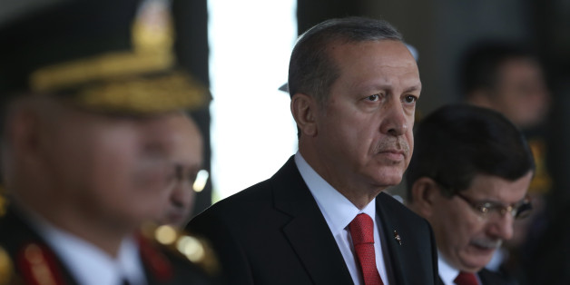 Turkish President Recep Tayyip Erdogan stands at the mausoleum of Turkey's founder Mustafa Kemal Ataturk on Victory Day in Ankara, Turkey, Sunday, Aug. 30, 2015. Turkish army's 93-year-old victory over Greece was considered crucial in Turkish Independence War and the foundation of modern Turkish republic. (AP Photo/Burhan Ozbilici)