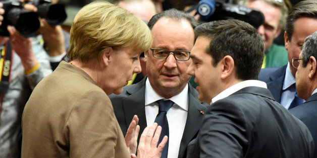 German Chancellor Angela Merkel, left,speaks with French President Francois Hollande, center, and Greek Prime Minister Alexis Tsipras, right, during a round table meeting at an EU summit in Brussels on Thursday, Feb. 18, 2016. European Union leaders are holding a summit in Brussels on Thursday and Friday to hammer out a deal designed to keep Britain in the 28-nation bloc. (AP Photo/Geert Vanden Wijngaert)