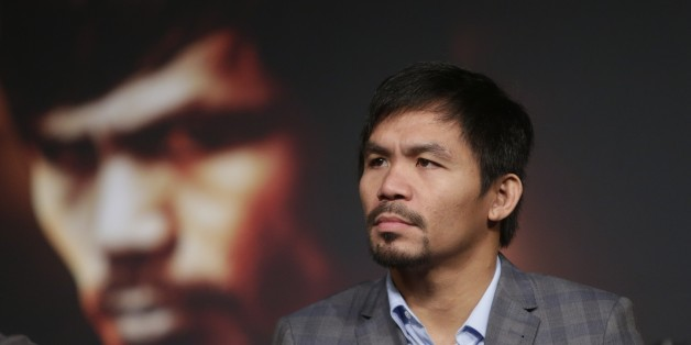 Manny Pacquiao listens during a news conference to promote an upcoming boxing match Thursday, Jan. 21, 2016, in New York. Pacquiao is scheduled to fight Timothy Bradley on April 9, 2016,  in Las Vegas.  (AP Photo/Frank Franklin II)