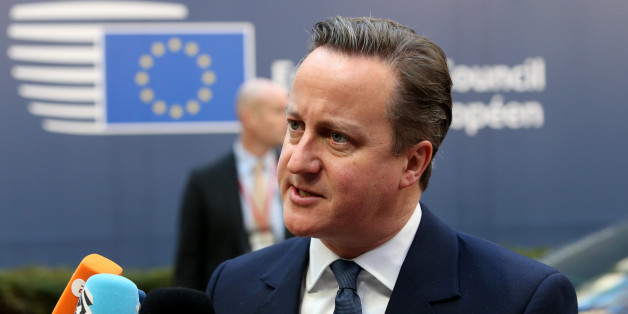 British Prime Minister David Cameron speaks with the media as he arrives for an EU summit at the EU Council building in Brussels on Friday, Feb. 19, 2016. British Prime Minister David Cameron faces tough new talks with European partners after through-the-night meetings failed to make much progress on his demands for a less intrusive European Union. (AP Photo/Francois Walschaerts)