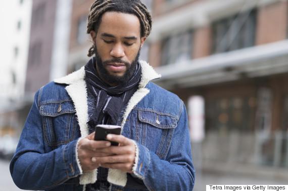 man texting phone serious