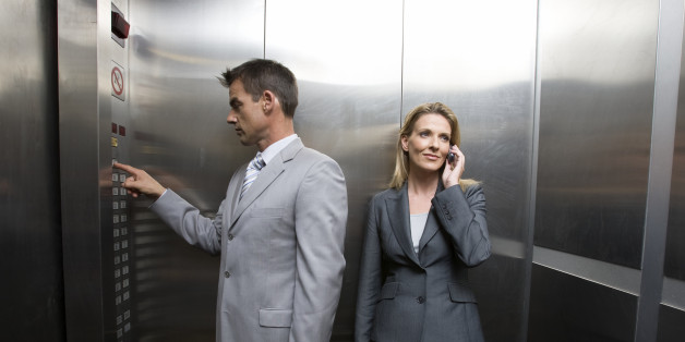 Two business people in elevator