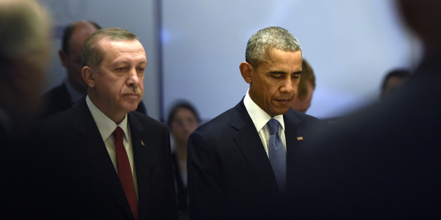 U.S President Barack Obama, right, and Turkey's President Recep Tayyip Erdogan during a moment of silence for those who died in Friday's attacks in Paris, at the start of a working session of the G-20 Summit in Antalya, Turkey, Sunday, Nov. 15, 2015. Obama is attending the G-20 Summit while on a nine-day foreign trip that also includes stops in the Philippines and Malaysia for other global security and economic summits. (AP Photo/Susan Walsh)