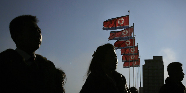 "North Korean men and women are silhouetted with their country's national flags in the background during a mass dance party as part of celebrations of the ""Day of the Shining Star"" or birthday anniversary of late North Korean leader Kim Jong Il on Tuesday, Feb. 16, 2016, in Pyongyang, North Korea. The celebrations of the Kim's birthday anniversary, a revered national holiday, came as South Korea's president warned that North Korea faces collapse if it doesn't abandon its nuclear weapons"