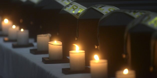 Funerary urns containing remains of people disappeared during the Colombian civil war, are seen, during a ceremony in the framework of the country's peace process in Medellin, Antioquia department, Colombia on August 29, 2014. Relatives of 19 victims received the remains of their loved ones, who were recently found in a mass grave, thanks to information provided by demobilized from both sides, the leftist guerrillas and the right-wing paramilitaries groups.  AFP PHOTO/Raul ARBOLEDA        (Photo credit should read RAUL ARBOLEDA/AFP/Getty Images)